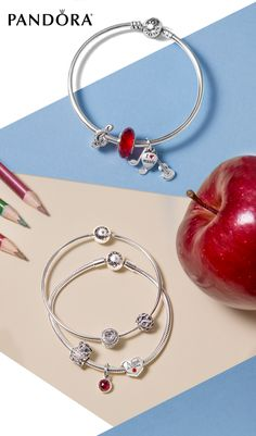 Head back into the classroom in style! Show off how much teaching means to you with a unique message in sterling silver from PANDORA.