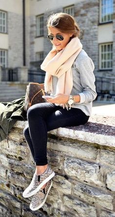 A chunky scarf, leggings and slip on sneakers make for a perfect fall outfit!