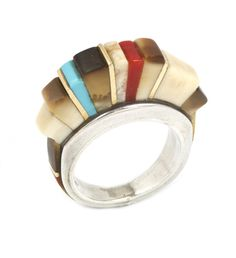 Ring | Charles Loloma.  Sterling silver inlayed with fossil ivory, turquoise and coral with 14k gold accents