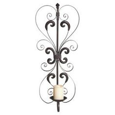 Bring the rustic beauty of wine country to your home d�cor with this artfully crafted design.  Product: Wall sconceConstruction Material: MetalAccommodates: (1) Pillar candle - not includedDimensions: 30 H x 12.25 W x 6.5 D