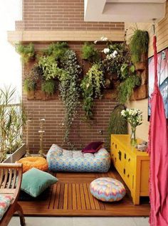 Hanging Garden Balcony with beautiful yellow chest of drawers, floor pillows, and bamboo flooring | small garden