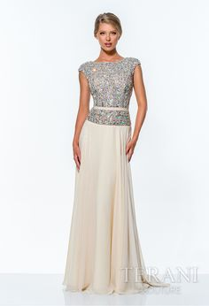 Shine like a diamond in this dazzling gown. The bodice and cap sleeves are encrusted with gorgeous, iridescent crystals that glitter and glow. A delicate ribbon accent at the waist adds a bit of elegance as the flowing chiffon train sweeps the floor. The classic A-line silhouette of the dress makes a royal statement and is perfect for your next formal event. http://www.trendycollection.com/terani-couture-item-13355&category_id=0&brands=7&click=brands