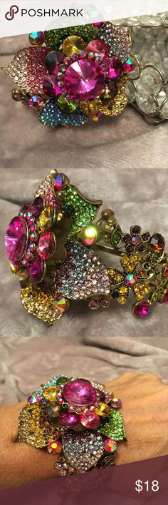 🌺One of a kind flower bracelet!🌺 Statement piece! Metal flower hidden hinge bracelet! 🌺 Every color of the rainbow here!🌈 Wear with anything for so many compliments! Sturdy and easy to wear! You won't find this piece everywhere! So lovely and feminine 🌺 Jewelry Bracelets