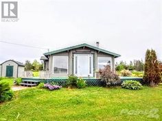 A cozy water view year round or summer home.  Sit on the deck and enjoy the water views, boating, sailing, kayaking, swimming, water skiing, just launch your boat and go!!  Located just 7 minutes to