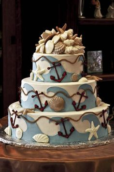 Wedding Cake by www.konditormeister.com...take away the anchors and chain line and modify the top to be much less fuss, and there may be a possible beach idea cake!