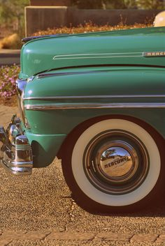 aqua vintage car.  I would love some white walls. I just need to right car first..