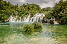 From Dubrovnik's city walls to the cascading waterfalls in Plitvice National Park and island hopping along the Dalmatian Coast, here are must-see spots to add to your Croatia itinerary. Krka National Park Croatia, Croatia Itinerary, Road Trip Europe, Dubrovnik, The Good Place, Travel Destinations, National Parks, Island, Places