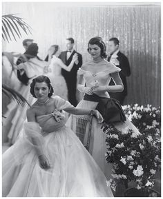 Jackie at a debunate ball, with her personally invited attendee, her sister Lee.