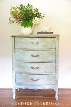 """I played around with layering again using not only annie sloan chalk paint but with craft paint as well. I used a turquoise craft paint and watered it down really well making a wash. I also used the new crackle tex. IThe top is just a layer of coco chalk paint with dark wax and a good sanding to bring some of the old color through. The hardware was too """"new"""" looking so I dry brushed them with a little french linen and then gave them a good dark wax."""