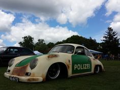 Porsche 356, slammed and rocking a German police paint scheme with patina.