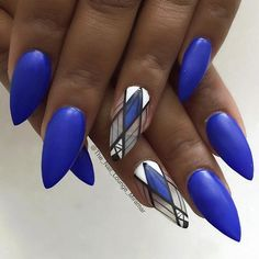 Amazing looking matte blue nail art design. This striking nail art design uses matte blue as the base color with intricate tribal themed details for effect.