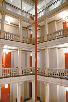 White Neo Classical Corridors with orange doors at the Hotel de la Paix Geneva Switzerland | Flickr - Photo Sharing!