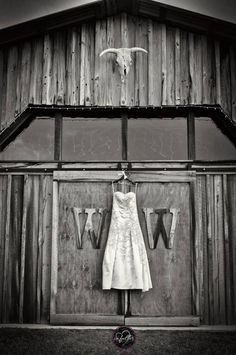 barn wedding, vintage / rustic barn, hanging wedding dress, black and white