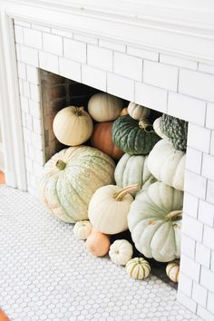 Pumpkins in a faux fireplace //