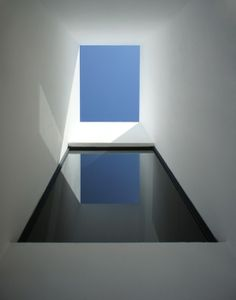 Sunroof. White walls. indoor pool. HDJ58 Casa estudio / T38 + Pablo Casals-Aguirre