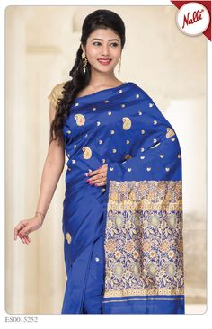 Pure royalty and elegance! Royal Blue Banaras Silk Saree with heavy thread work on butta and rich artistic motifs on a body. The artwork compliments the saree without a border.#Iwearhandloom.