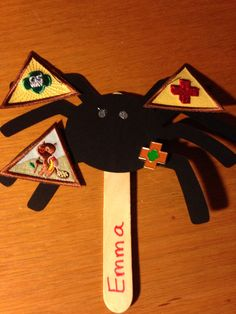 Wanted a special way to present Girl Scout badges earned - this spider cut from card stock does the trick