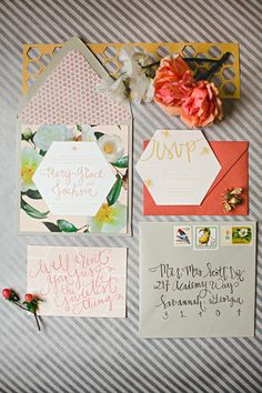 Floral honeycomb invitations in a cheery color scheme of coral, mustard, taupe, and dusty blue.