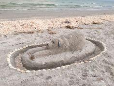 dog and bone sand sculpture art