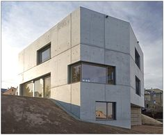 This concrete home design by Atelier ST is located on an urban block of Zwickau, Germany, built on a hillside overlooking the river below. Shipping Container Home Designs, Container House Design, Beton Design, Concrete Design, Tadao Ando, Minimalist Window, Minimal Living, Concrete Building, Built Environment