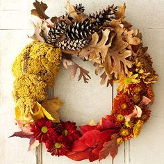 Dress up your door with a Fall Bounty Wreath, made from pinecones, leaves and harvest-colored flowers. http://www.parents.com/holiday/thanksgiving/decorating/creative-fall-wreaths-pumpkins--pom-poms--more/?socsrc=pmmpin100412cFallBountyWreath#page=2