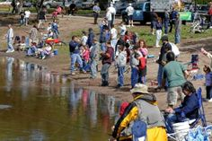 More than 200 youngsters and their families participate in the township's annual Mayor's Fishing Contest on the banks of the pond in the Ott...