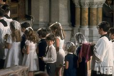 JFK Jr looking back alongside sister Caroline and other Kennedy children at his uncle's funeral, New York, by Bob Gomel 1968