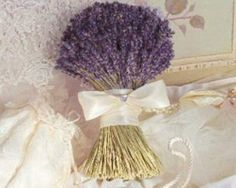 I'm not sure if it will be in season, but lavender sprigs would be a nice way to accent the bouquets or centerpieces to match the dresses. And they smell lovely.