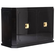 Tommi Parzinger Black Lacquer Commode  USA  1950's  Tommi Parzinger for Parzinger Originals black lacquer buffet/ commode with raised front and side panels and iconic brass hardware. Cabinet features camel lacquer interior with 5 drawers on one side and 2 adjustable shelves on the other.