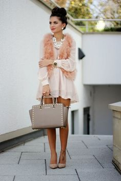 fur vest, studded bag, updo