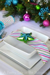 A Colourful Christmas Table! - A Pretty Life In The Suburbs - Use white and silver instead - love the ribbon around the plates