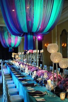 Wow, purple and turquoise wedding colors. Ceiling drapery sure creates a dramatic scene.