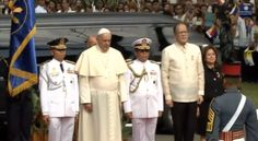 Pope Francis, along with the president, pays attention as the national anthem plays.