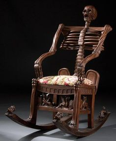 """Description: A intricately carved mahogany """"momento morie"""" rocking chair depicting a skeleton figure on rockers terminating in dragons. Probably modeled after the Mid Century Russian example as illustrated in century European Furniture by Christ Gothic Furniture, European Furniture, Funky Furniture, Unique Furniture, Skull Furniture, Gothic Chair, Furniture Design, Victorian Chair, Hardwood Furniture"""