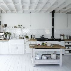 White kitchen with classic features An antique Belfast sink and rustic butcher's block complements the scheme, while Metro-style white tiling creates a vintage-inspired splashback. Sinks Wickes