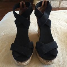 """Black canvas Tory Burch espadrilles These Tory Burch Black canvas, elastic, ankle wrap strapped espadrilles are super fun and comfy!!!  I barely worse then so they are in perfect, pristine condition with no flaws at all.  The sole is almost perfect!  The heel is 4 1/2"""" and has a 1"""" platform all covered in woven natural fibers. Tory Burch Shoes Platforms"""