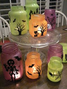 Mix Elmer's White Glue with your choice of craft paint colors and paint the inside a clear jars.  Let it dry, then add silhouette stickers to the outside and put your tealight candle on the inside!  These are Halloween lanterns, but you could do this with any holiday or theme!