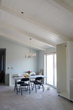 Benjamin Moore's Simply White in an eggshell finish ceiling. Walls -Benjamin Moore's Quiet Moments.