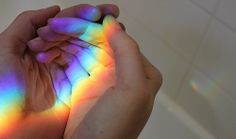 {she held rainbows in her hands, but she held rain in her heart}