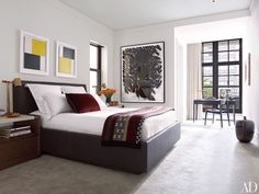 In the bedroom, a #modern bed with an #Hermes throw #blanket become a focal feature