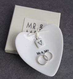 'Mr And Mrs' Ceramic Ring Dish  Gorgeous heart shaped 'Mr & Mrs' wedding ring plate with box. This sweet little heart shaped ceramic dish is the perfect wedding gift. It is multi functional. You could use it on the big day to keep the rings on or afterwards in the home to keep them safe if you need to remove them briefly. It could also be used as a decorative ornament for the home. Beautiful.