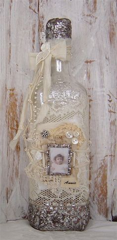 Altered vintage bottle..then use vintage scrap fabric and broken jewelry to create a pretty knack