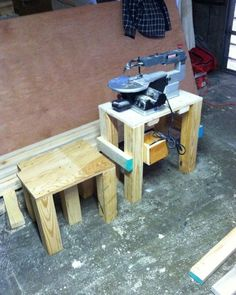 Scroll saw stand with stool.