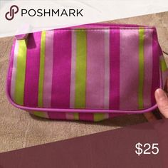 """Striped Makeup Bag Makeup bag with vertical purple and lime green stripes. Dimensions are 8.5"""" L x 4.5"""" H x 2"""" W. Makeup Brushes & Tools"""