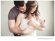 Nice pose to include both parents with a newborn and not make the baby look too tiny
