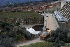 Dramatic new images show scale of damage to Oroville Dam spillway -  February 28, 2017:    Workers move boulders to aid and repair the emergency spillway of the Oroville Dam on Monday, Feb. 13, 2017 in Oroville, Calif. Nearly  200,000 people downriver from Lake Oroville were ordered to evacuate Sunday night, after an emergency spillway next to the reservoir�s  dam appeared in danger of collapse.