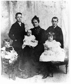 "Nackie Scripps, wife of E.W. Scripps, and children, 1896. Nackie poses with five of the six children from her marriage to E.W. Scripps. Standing left, James George, 10, and right, John Paul, 8. Seated left is Edward ""Teddy"" Willis Mclean, 5, who died three summers later. Seated right is Dorothy Blair ""Dolla"" 6. In mother's lap is Robert Paine, about 6 months old. Their sixth child, Nackey Elizabeth, was not born until May 1898."