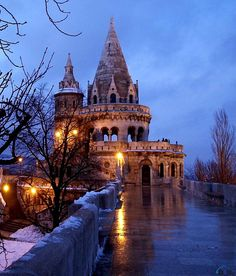 "Fishermans Bastion, Budapest, Hungary:  ""Entrance to Nephele"" Entrance on the ground- wind gust tunnels up to the castles in the clouds. Ride the columns of wind up on magic carpets"