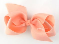 {DETAILS} Handmade Loopy Hair Bow in Peach. (Turquoise shown for size reference) Bow measures 3.5, made with 1.5 wide ribbon, features smooth tails and a perfectly knotted center.  Partially lined 1.75 (4.5 cm) single prong alligator clip Non-Slip Grip Treated ends to prevent fraying High quality ribbon  {SHIPPING} Hair bows are in stock and ready to ship!  All USA orders are shipped First Class Mail with tracking and delivery confirmation. International orders are shipped via USPS First…