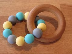 Wooden Silicone Teething Ring A beautiful natural & colourful teether that your baby will love! The wooden ring is made from natural Wooden Rings, Teething, Wax, Natural, Etsy, Beautiful, Fasteners, Wood Rings, Nature